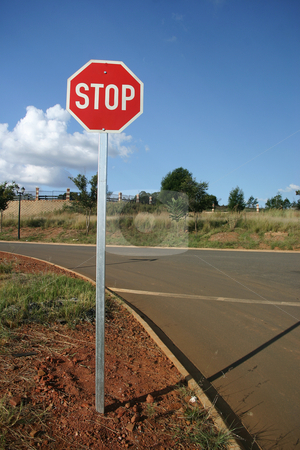 Red Stop Sign stock photo, Stop sign against a blue sky by Sean Nel