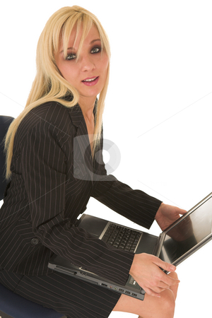 Sexy blonde businesswoman stock photo, Sexy young adult Caucasian businesswoman in black pinstripe pencil skirt and suit jacket on a white background, sitting on an office chair with a notebook computer by Sean Nel
