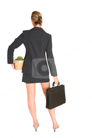 Laura Hopton #17 stock photo, Business woman standing, holding suitcase and potplant, - full length by Sean Nel