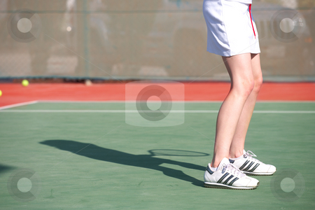 Female Tennis Player stock photo, Legs of a young woman playing tennis in the sun by Sean Nel
