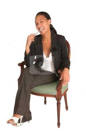 Mida Matsimela #7 stock photo, African business woman dressed in black jacket. Sitting on chair, holding a pen by Sean Nel