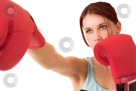 Gym #66 stock photo, Woman boxing, depth of field. Face in focus, gloves out of focus. by Sean Nel