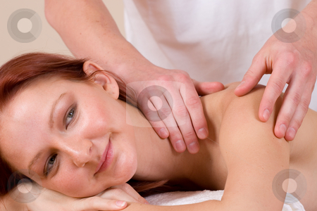Massage #29 stock photo, Woman lying on massage table with the hands of male masseuse on her back and shoulders by Sean Nel