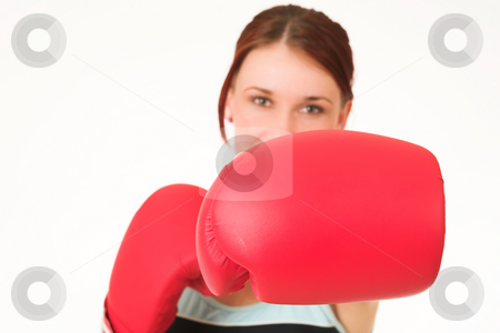 Gym #38 stock photo, A woman in gym clothes, with boxing gloves.  Shallow D.O.F. - woman out of focus, boxing gloves in focus. by Sean Nel