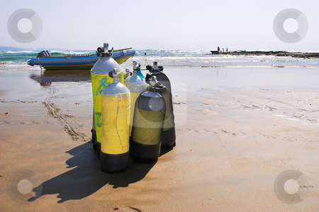 Sudwana #25 stock photo, The beach at Sudwana with diving equipment in the foreground and a motorboat in the background by Sean Nel