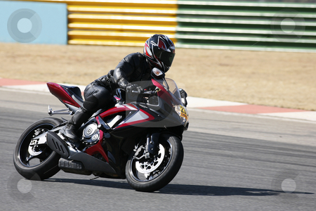 Superbike #91 stock photo, High speed Superbike on the circuit  by Sean Nel
