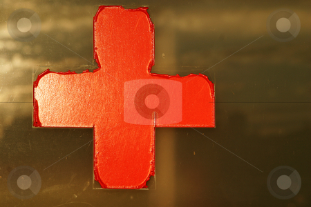 Red cross on window stock photo, Old red cross sign on window by Sean Nel