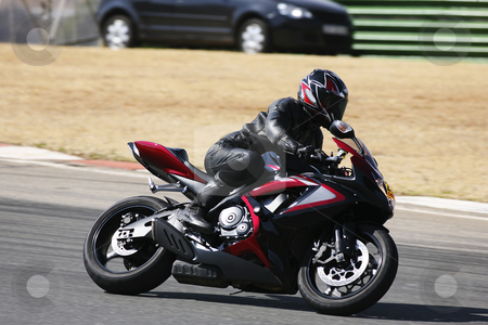 Superbike #92 stock photo, High speed Superbike on the circuit  by Sean Nel