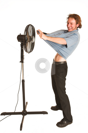 David Badenhorst #8 stock photo, Man with blue shirt cooling down in front of a fan. by Sean Nel