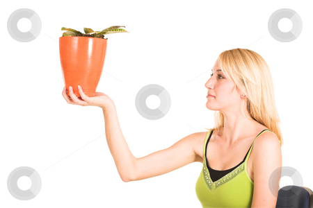 Businesswoman #465 stock photo, Blonde business lady in an informal green top. Holding a pot plant.  copy space. by Sean Nel