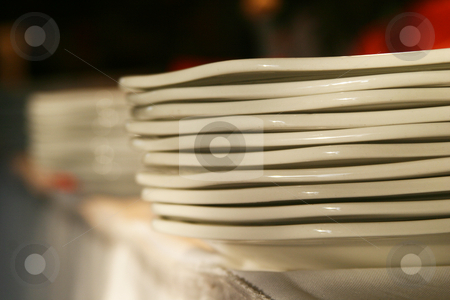 Stacked plates stock photo, Plates stacked on a table by Sean Nel