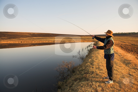 Flyfishing #26 stock photo, A fly fisherman casting a line in Dullstroom, South Africa by Sean Nel