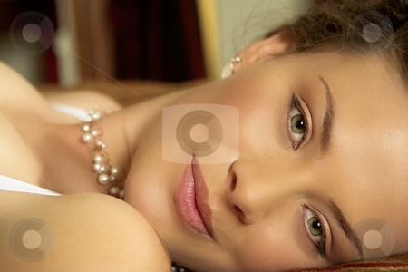 Lingerie#249 stock photo, Woman in underwear lying on a bed. by Sean Nel