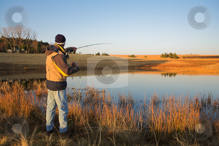 Flyfishing #19 stock photo, A fly fisherman casting a line in Dullstroom, South Africa by Sean Nel
