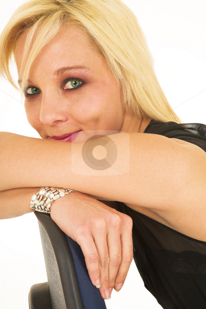 BlondeFace #6 stock photo, Green eyed blonde lady with silver jewelry on an office chair by Sean Nel