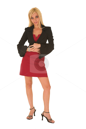 Sexy blonde businesswoman stock photo, Sexy young adult Caucasian businesswoman in a short red dress with a black jacket on a white background by Sean Nel