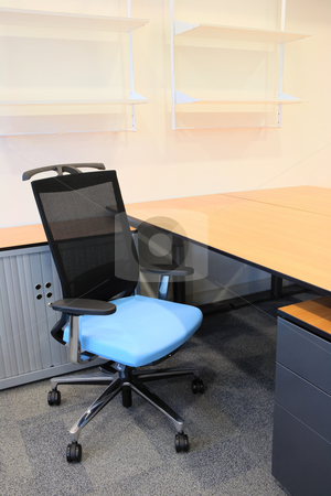 Interior of a new office stock photo, Empty office with new modern office furniture, including desks, cupboards, filing cabinets and chairs. blue chair facing out. HDR type image by Sean Nel
