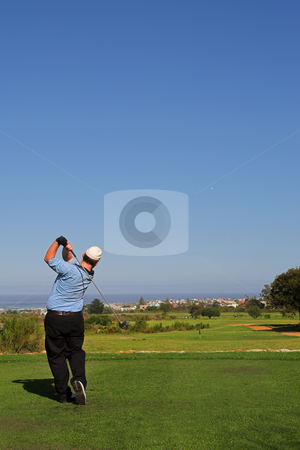 Golfer #67 stock photo, A golfer playing golf on a green.  Movement on the golf club and ball by Sean Nel