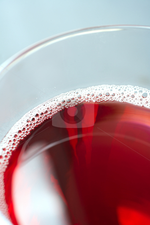 Red wine stock photo, Glass of freshly poured red wine by Sean Nel