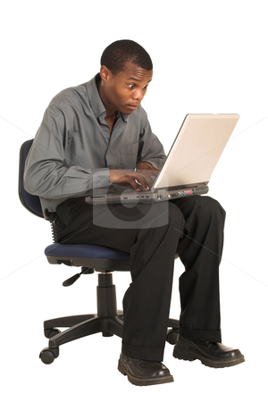 Businessman #157 stock photo, Businessman wiht grey shirt sitting on an office chair, working on a laptop. by Sean Nel