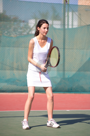 Female Tennis Players stock photo, Young women playing tennis in the sun - Focus on hands by Sean Nel