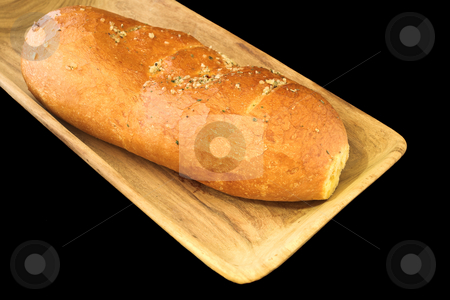 Bread #5 stock photo, Loaf of bread on wooden board on black background by Sean Nel