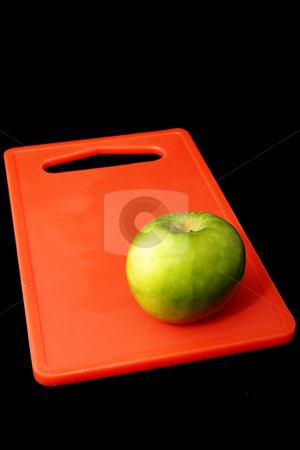 Apple #6 stock photo, Red apple on red cutting board - black background by Sean Nel