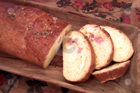Bread #10 stock photo, Loaf of bread on wooden board - flower background by Sean Nel