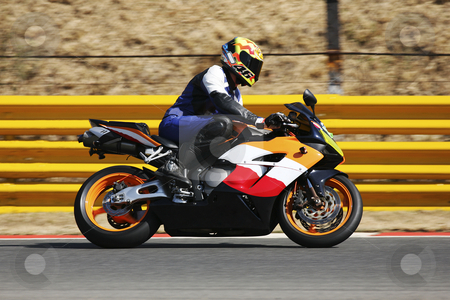 Superbike #57 stock photo, High speed Superbike on the circuit  by Sean Nel