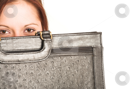 Business Woman #335 stock photo, Business woman with brown hair, peeking over a leather suitcase.  Copy space by Sean Nel