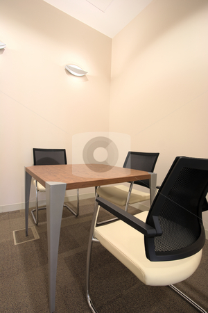 Interior of a new office stock photo, Empty small boardroom with new modern office furniture, including desks and chairs. HDR type image by Sean Nel