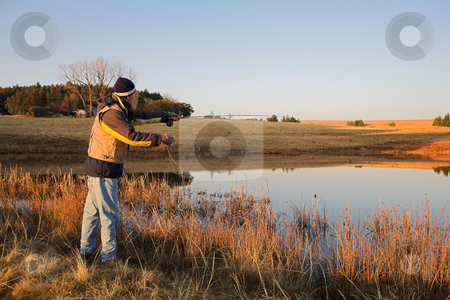 Flyfishing #22 stock photo, A fly fisherman casting a line in Dullstroom, South Africa by Sean Nel