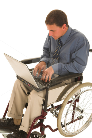 Businessman #135 stock photo, Businessman working on a laptop in a wheelchair by Sean Nel