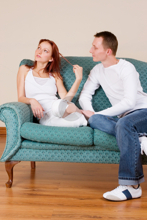 Trudy-Lee & Tommy #6 stock photo, Woman and boyfriend sitting on couch, talking by Sean Nel
