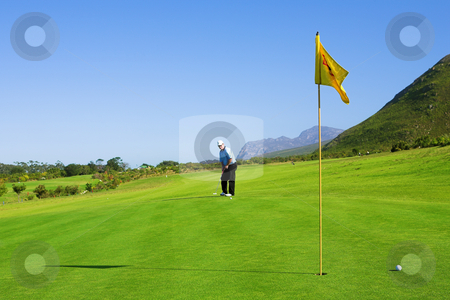 Golfer #63 stock photo, A golfer playing golf on a green. by Sean Nel