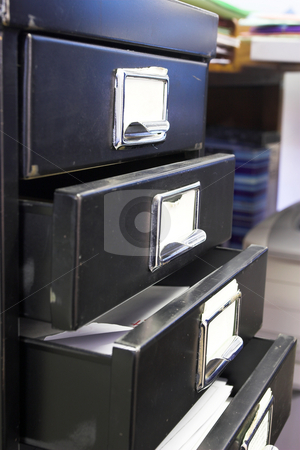 Filing cabinet #4 stock photo, Close-up of a black mini filing cabinet and label with four open drawers by Sean Nel