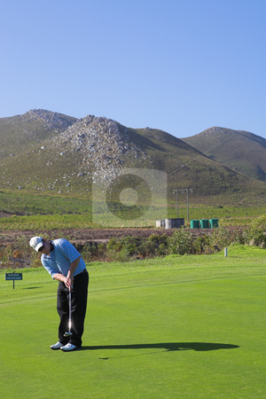 Golfer #53 stock photo, A golfer playing golf on a green. by Sean Nel