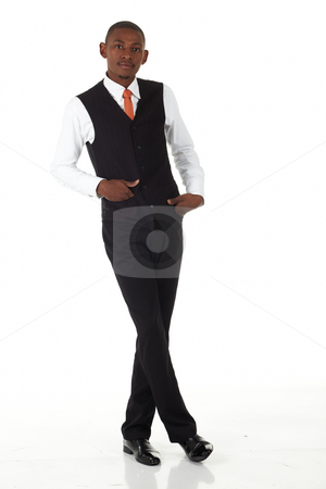 Black African Businessman stock photo, Young black african businessman in a formal suite and on a white background standing cross legged - NOT ISOLATED by Sean Nel