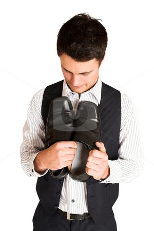 Businessman #110 stock photo, Businessman holding his shoes.  Looking down at shoes. by Sean Nel