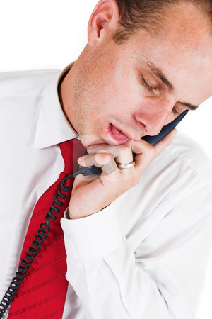 Business man #25 stock photo, Business man in a suit with a blue telephone by Sean Nel