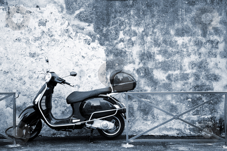 Antibes #60 stock photo, Scooter in front of a wall.   Blue tone. Copy space. by Sean Nel
