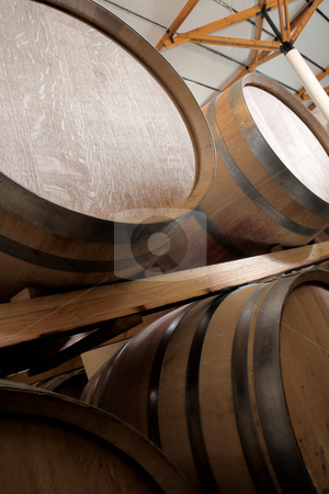 Oak barrels maturing red wine and brandy stock photo, Stacked Oak barrels for maturing red wine and brandy in a cooling cellar. Made from American and Canadian oak and stacked in rows. (low noise HDR file  by Sean Nel