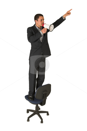 Businessman #239 stock photo, Businessman wearing a suit and a grey shirt.  Making a stunt on an office chair with a megaphone in his hand, pointing upwards with the other hand. by Sean Nel
