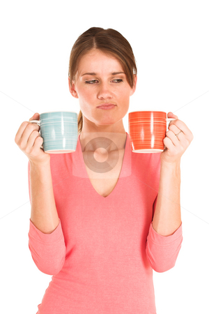 Business Woman #433 stock photo, Brunette business woman in  an informal light pink shirt. Portrait.  Holding two cups, looking confused. by Sean Nel