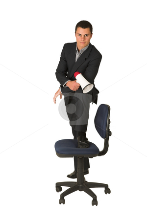 Businessman #253 stock photo, Businessman wearing a suit and a grey shirt.  Making a stunt on an office chair with a megaphone in his hand by Sean Nel