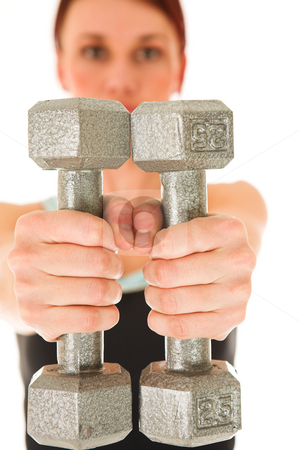 Gym #8 stock photo, A woman in gym clothes, holding weights out in front of her.  Shallow DOF  by Sean Nel