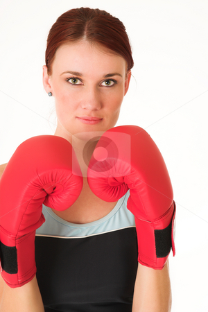 Gym #36 stock photo, A woman in gym clothes, with boxing gloves by Sean Nel