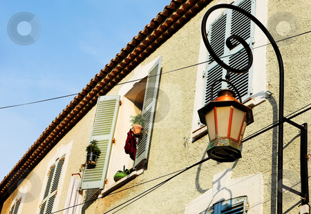 Building in Antibes stock photo, Building with shutters on windows and street light in Antibes, France. by Sean Nel
