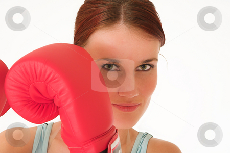 Gym #37 stock photo, A woman in gym clothes, with boxing gloves by Sean Nel