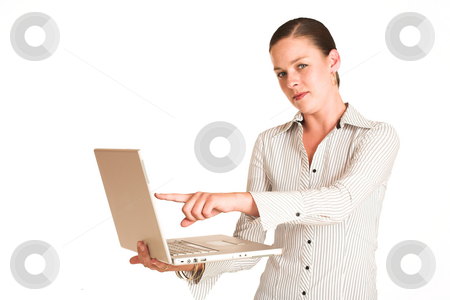 Business Woman #38 stock photo, Business woman dressed in a white pinstripe shirt.  Pointing at laptop by Sean Nel